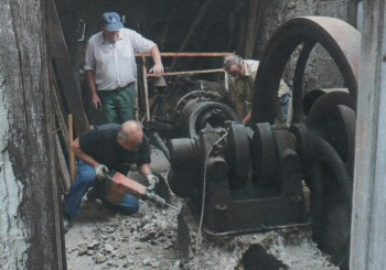 Gas Engine being removed from artisan's workshop