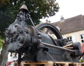 Gas Engine loaded on lorry after removal from artisan's workshop